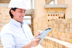 Civil engineer with a tablet Royalty Free Stock Photo