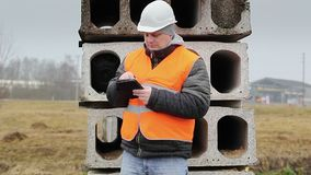 Civil engineer with tablet PC in construction panels stock footage