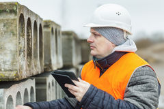 Civil engineer with tablet PC near the construction panels Stock Photo