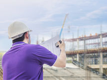 Civil engineer at work. Civil engineer is inspecting his work in building construction site Royalty Free Stock Photo