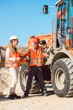 Civil engineer and worker discussion on road construction site Stock Photography
