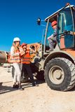 Civil engineer and worker discussion on road construction site Royalty Free Stock Image