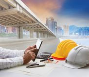 Civil engineer working table and urban building with infra struc. Civil engineer working table   and urban building with infra structure development Royalty Free Stock Photo