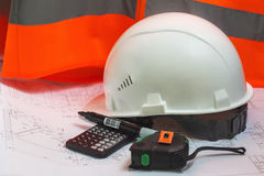Civil Engineers accessories. Accessories Engineer builder on a background of an orange vest and project solutions royalty free stock images
