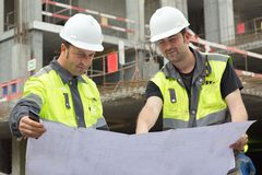Civil Engineers At Construction Site Royalty Free Stock Photo