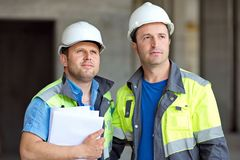 Civil Engineers At Construction Site Royalty Free Stock Photos