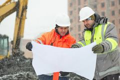 Civil engineers at construction site in winter season Royalty Free Stock Image