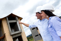 Civil engineers pointing at a house Royalty Free Stock Photo