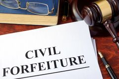 Civil forfeiture. Civil forfeiture, documents and gavel on a table Stock Photo