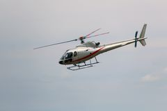Civil helicopter flies in the sky and carries tourists for sight. Light civil helicopter flies in the sky and carries tourists for sightseeing Royalty Free Stock Images