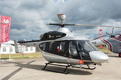 Civil helicopter on the ground Stock Photo
