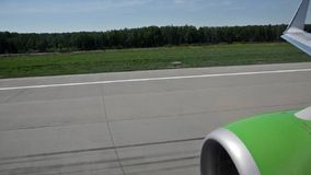 Civil jet accelerates and takes off stock video footage