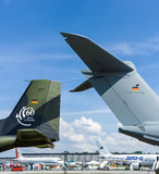 Civil and military aircraft on the airfield. Royalty Free Stock Photography