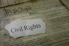 Civil Rights concept. Civil Rights newspaper headline on a copy of the US Constitution Stock Photos