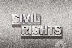 Civil rights on metallic. Civil rights phrase made from vintage letterpress on metallic textured background Royalty Free Stock Photos