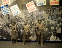 Civil Rights Protesters Exhibit inside the National Civil Rights Museum at the Lorraine Motel. African American statues with protest signs exhibit inside the stock photo