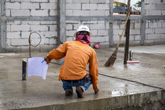 Civil technician or engineer is measuring concrete Royalty Free Stock Photos