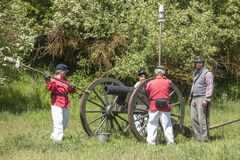 Civil war artillery reenactors load canon. Royalty Free Stock Image