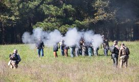 Civil War Battle Reenactors Firing a Rifle Volley stock photos