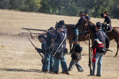 Civil War Battle. Union soldiers aim and reload during a Civil War reenactment at Hawes Farm in Anderson, California on October 4, 2015 Stock Images