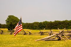Civil War battlefield and flag. An lone American Civil War flag flies inside a split rail barricade on the Manassas Battlefield, Manassas, Virginia stock images