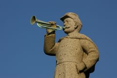 Civil War Bugler. This stone, bugler stands atop a monument in a cemetery to honor veterans of Civil War Royalty Free Stock Photo
