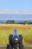 Civil War Cannon Aimed at Battlefield Gettysburg Pennsylvania. Civil War cannon aimed out over the fields of the Gettysburg Battlefield in Gettysburg Royalty Free Stock Photo