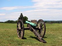 Civil war cannon with house 1. Civil war cannon with house in background royalty free stock image