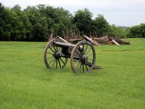 Civil war cannon 2. A civil war cannon with a log wall in the background royalty free stock photo