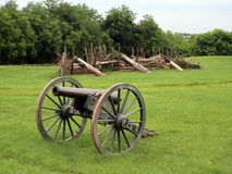 Civil war cannon with defensive position 1. A civil war cannon with a log wall in the background royalty free stock photography