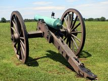 Civil war cannon with mounment 1. Civil war cannon with man on a horse in the background stock image