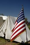Civil War Enactment 9. Tents and flag on display at a civil war encampment Royalty Free Stock Photos
