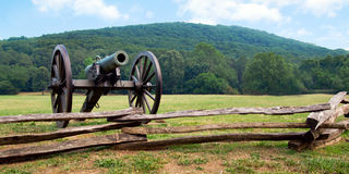 Civil War era cannon overlooks battlefield Royalty Free Stock Photography