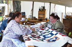 Civil-war era reenactors quilting Royalty Free Stock Photos