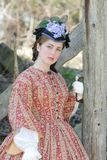 Civil war era woman. Outdoor portrait of an attractive young girl in a Civil War era 1860s dress stock photography