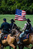 Civil war flag and union soldiers. Union soldiers carry an old  Civil war American flag, during a Reenactment from the 2012 Jackson Michigan Civil war muster Stock Photo
