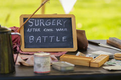 Civil War re-enactment. Black chalk  board with white hand written text   Surgery after Civil War  Battle  and sharp knife for crude surgical procedures, part Stock Photo