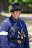 Civil War Reenactment. HUNTERSVILLE, NC - JUNE 6, 2015: Reenactor in a Union army uniform participating in an American Civil War battle reenactment at Historic royalty free stock photography