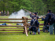 Civil war reenactment. Union soldiers prepare to fire on the confederates in a civil war reenactment Stock Image