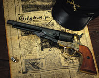 Civil War Revolver. A Civil War-Era revolver with bullet, civil war hat, and map of Gettysburg stock photo