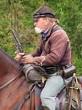 Civil War soldier on horse. Close-up of a Union re-enactment American Civil War soldier mounted on a horse holding a pistol Royalty Free Stock Photos