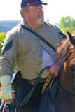 Civil War Soldier on Horseback. Buchanan, VA - April 26; A Civil War soldier on horseback in Civil War period clothing at the Buchanan Civil War History Weekend Stock Photo