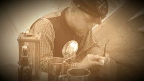 Civil War soldier preps his tobacco pipe (Archive Footage Version)