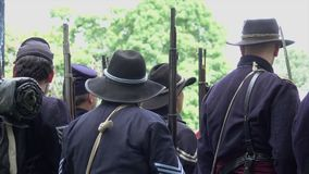 Civil War soldiers from behind. View of Civil War soldiers from behind stock footage