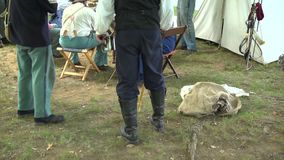 Civil War soldiers in camp with chicken stock video footage