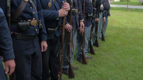 Civil War soldiers come to attention stock footage