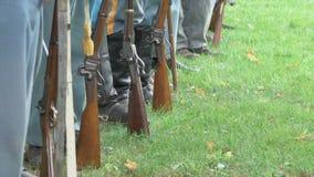 Civil War soldiers feet and guns in a row. Scene of Civil War soldiers feet and guns in a row stock video