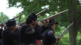 Civil War soldiers fire of rounds. View of Civil War soldiers fire of rounds stock video footage