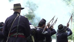 Civil War soldiers firing guns in formation stock video