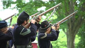 Civil War soldiers firing uphill stock video footage